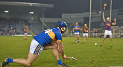Jason Forde converts a sideline cut for Tipperary during the Allianz NHL clash against Wexford. Photo: Sportsfile