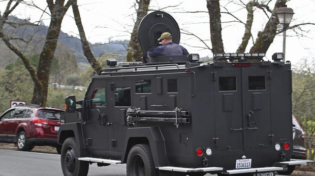 An armoured vehicle arrives at the Veterans Home of California (Ben Margot/AP)