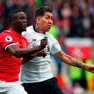 Manchester United's Eric Bailly (left) and Liverpool's Roberto Firmino
