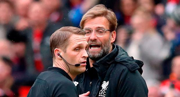 Referee Craig Pawson speaks to Liverpool manager Jurgen Klopp during the Premier League match at Old Trafford