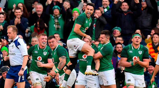 Ireland players and supporters celebrate after Sean Cronin scored their side's fourth try during the NatWest Six Nations Rugby Championship match between Ireland and Scotland at the Aviva Stadium in Dublin. Photo by Brendan Moran/Sportsfile