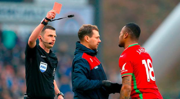 Swansea City's Jordan Ayew (right) is shown the red card by referee Michael Oliver during the Premier League match at the John Smith's Stadium, Huddersfield. PRESS ASSOCIATION Photo. Picture date: Saturday March 10, 2018. See PA story SOCCER Huddersfield. Photo credit should read: Mike Egerton/PA Wire. RESTRICTIONS: EDITORIAL USE ONLY No use with unauthorised audio, video, data, fixture lists, club/league logos or