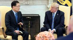 South Korea's national security chief Chung Eui-yong with President Trump, who is willing to talk to North Korea. Photo: Reuters