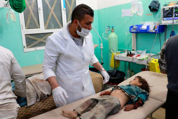 A doctor and a child victim of an air strike on the outskirts of Saada, Yemen, last week. Photo: Naif Rahma/Reuters