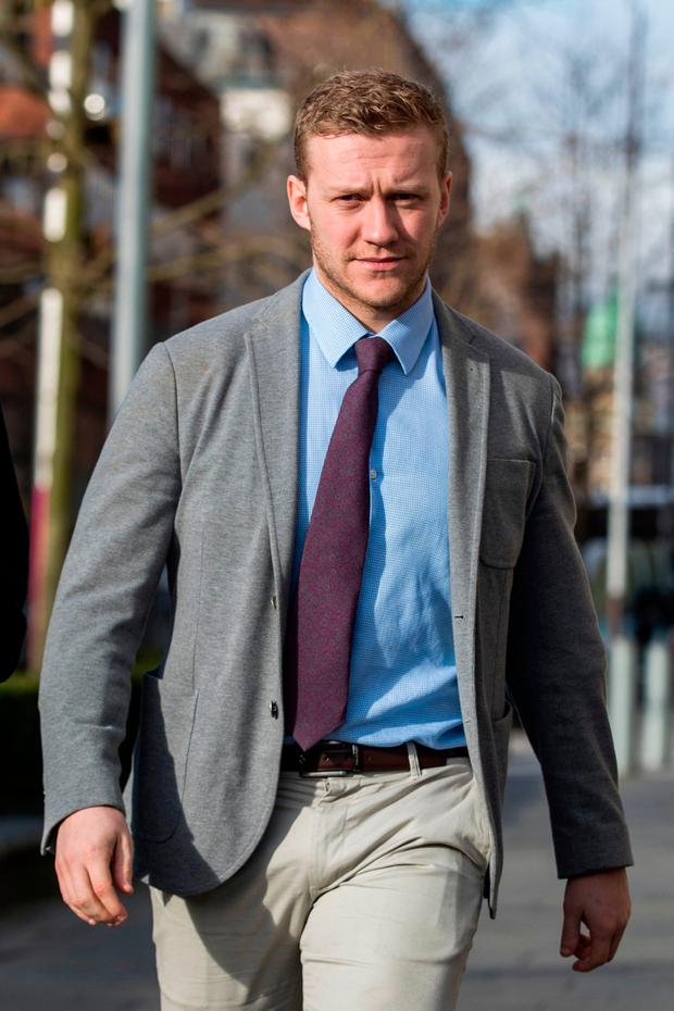 Ireland and Ulster rugby player Stuart Olding arrives at Belfast Crown Court. Photo: PA