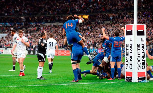 France celebrate at the final whistle after securing victory over England in Stade de France. Photo: PA