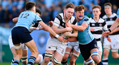 Ruadhan Byron of Belvedere College is tackled by Jay Barron, left, and Jody Booth of St Michael's College during the Bank of Ireland Leinster Schools Senior Cup semi-final match between St. Michael's College and Belvedere College at Donnybrook Stadium in Dublin. Photo: Sportsfile