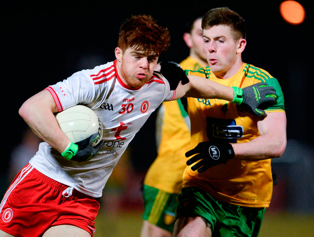 Tyrone's Cathal McShane holds off Donegal's Eaoghan Bán Gallagher during last night's Allianz League game in Omagh. Photo: Oliver McVeigh/Sportsfile