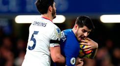 Crystal Palace's James Tomkins tries to get the ball back from Chelsea striker Alvaro Morata during last night's Premier League match at Stamford Bridge. Photo: Getty Images