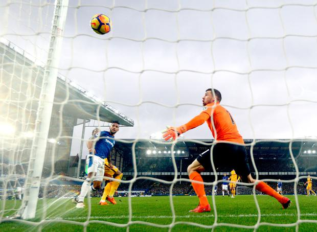 Gaetan Bong of Brighton and Hove Albion scores an own goal, Everton's first goal during the Premier League match. Photo: Getty Images