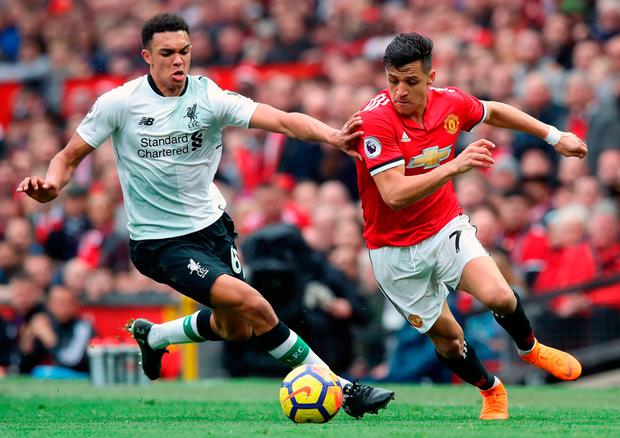 Liverpool's Trent Alexander-Arnold and Manchester United's Alexis Sanchez battle for the ball. Photo: Martin Rickett/PA