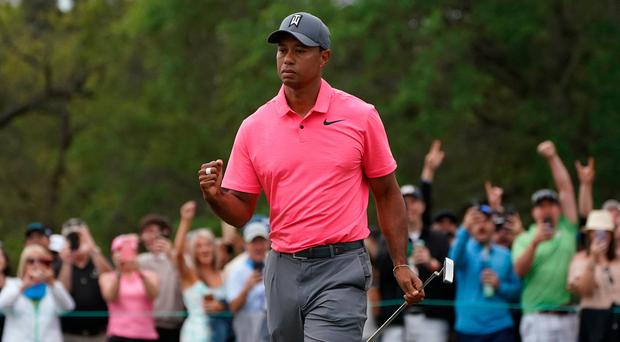 Tiger Woods pumps his fist after making a birdie putt on the 10th during the third round of the Valspar Championship golf tournament at Innisbrook Resort - Copperhead Course. Credit: Jasen Vinlove-USA TODAY Sports