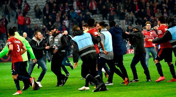 Lille' supporters invade the pitch at the end of the French L1 football match between Lille and Montpellier