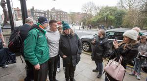 Jacob Stockdale and his partner Jessica Gardiner meets with fans while leaving the Shelbourne hotel after winning the Six Nations by beating Scotland. Pic:Mark Condren 11.3.2018