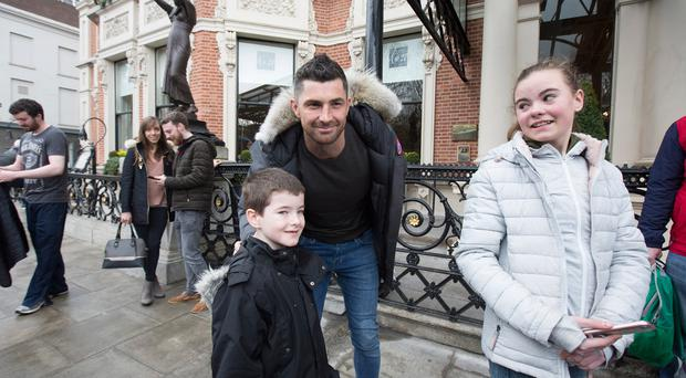 Rob Kearney meets fan Ciaran Halligan (8) from Naas while leaving the Shelbourne hotel after winning the Six Nations by beating Scotland. Pic:Mark Condren 11.3.2018