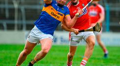 Padraic Maher of Tipperary in action against Alan Cadogan of Cork