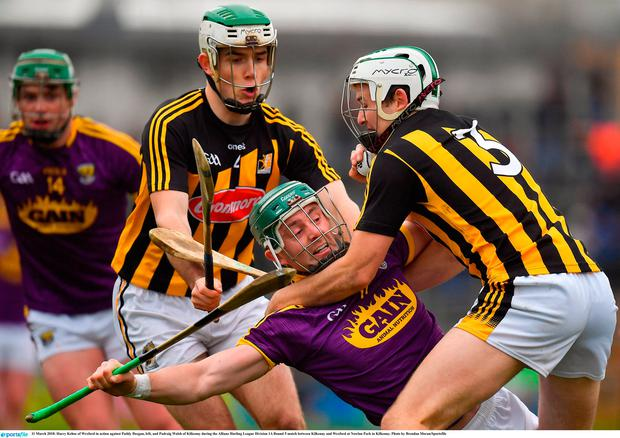 Harry Kehoe of Wexford in action against Paddy Deegan, left, and Padraig Walsh of Kilkenny