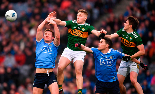Ciaran Kilkenny, left, and Paddy Andrews of Dublin in action against Peter Crowley and Ronan Shanahan, right, of Kerry