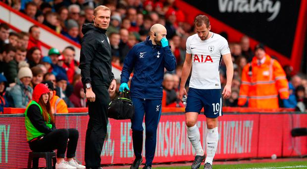 Tottenham Hotspur's Harry Kane leaves the pitch injured