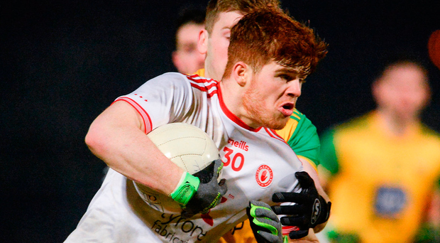 Cathal McShane of Tyrone breaks the tackle of Donegal's Eoghan Bán Gallagher. Photo: Sportsfile
