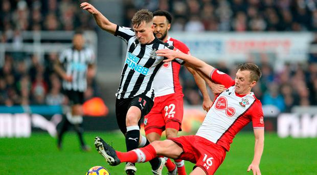 Newcastle United's Matt Ritchie and Southampton's James Ward-Prowse battle for the ball. Photo credit: Owen Humphreys/PA Wire.