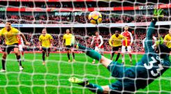 Troy Deeney of Watford sees his penalty saved by Petr Cech of Arsenal. Photo by Michael Regan/Getty Images