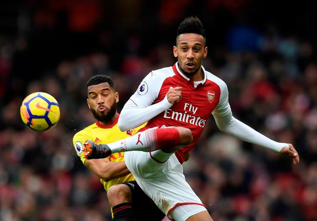 Watford's Adrian Mariappa in action with Arsenal's Pierre-Emerick Aubameyang. Photo: Reuters/Tony O'Brien