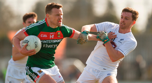 Andy Moran of Mayo holds off the challenge of Niall Kelly. Photo: Sportsfile