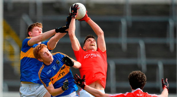 Louth's Andy McDonnell wins the high ball ahead of Tipp duo John Meagher (L) and Josh Keane. Photo: Sportsfile