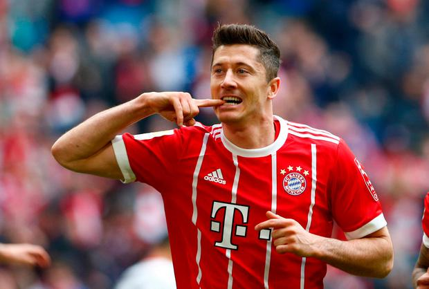 Robert Lewandowski scored his 100th Bundesliga goal for Bayern Munich, completing a hat-trick from the penalty spot. Photo: Reuters/Michaela Rehle