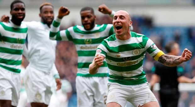 Scott Brown celebrates after Celtic's victory over Rangers at Ibrox. Photo: Reuters/Russell Cheyne