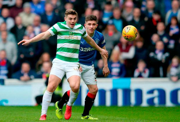 Rangers' Declan John (right) and Celtic's James Forrest battle for ball. Photo credit: Jane Barlow/PA Wire.