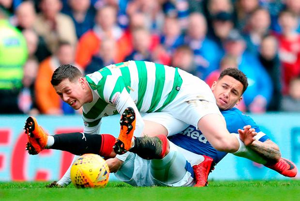 Rangers' James Tavernier (right) and Celtic's Callum McGregor in action. Photo credit: Jane Barlow/PA Wire.