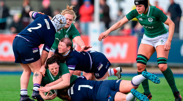 Ireland's Paula Fitzpatrick is tackled by Sarah Bonar, above, and Lana Skeldon of Scotland during yesterday's clash at Donnybrook. Photo by David Fitzgerald/Sportsfile