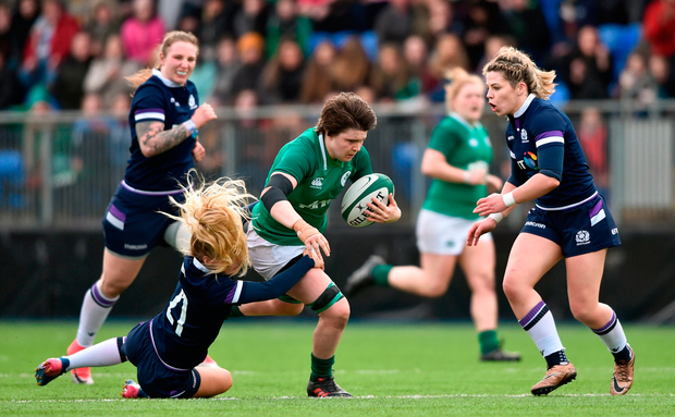 Ciara Griffin of Ireland is tackled by Jenny Maxwell of Scotland. Photo by David Fitzgerald/Sportsfile