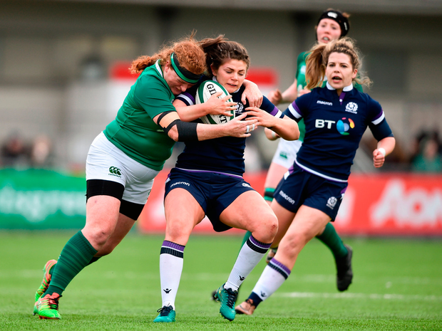 Lisa Thompson of Scotland is tackled by Fiona Reidy of Ireland. Photo by David Fitzgerald/Sportsfile