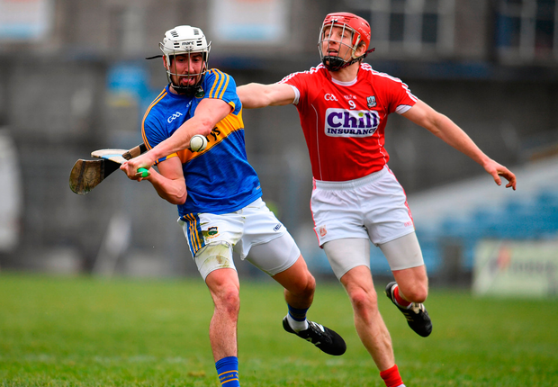 Cork's Bill Cooper hooks Tipperary's Patrick Maher in Thurles yesterday. Photo: Sportsfile
