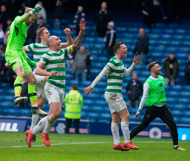 IBROX PARTY: Celtic players (l-r) Scott Bain, Kristoffer Ajer and Scott Brown celebrate their Old Firm win over Rangers at Ibrox yesterday. Photo: PA
