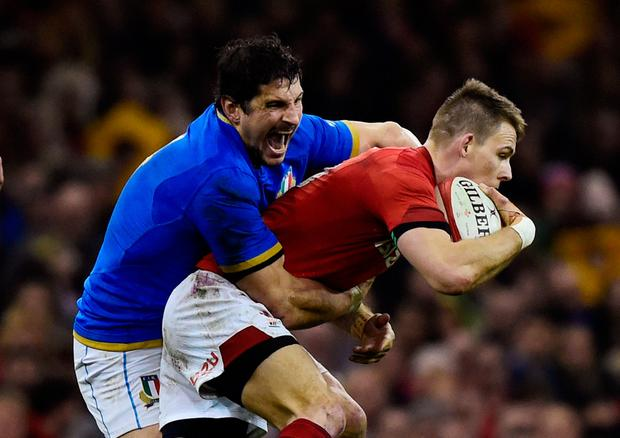 Wales' Liam Williams in action with Italy's Alessandro Zanni. Photo: Reuters/Rebecca Naden