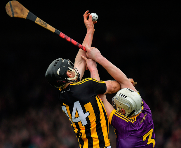 Walter Walsh of Kilkenny catches the sliotar ahead of Liam Ryan of Wexford. Photo: Sportsfile