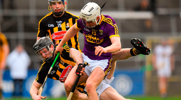 Kilkenny's Enda Morrissey is knocked to the ground in a collision with Wexford's Cathal Dunbar during yesterday's Allianz HL Division 1A clash at Nowlan Park. Photo: Sportsfile