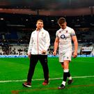 Dylan Hartley and Owen Farrell leave the field at the Stade de France after England's defeat in Paris. Photo by Dan Mullan/Getty Images