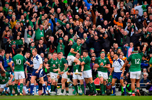 Conor Murray leaps highest in celebration after Sean Cronin's try. Photo by Brendan Moran/Sportsfile