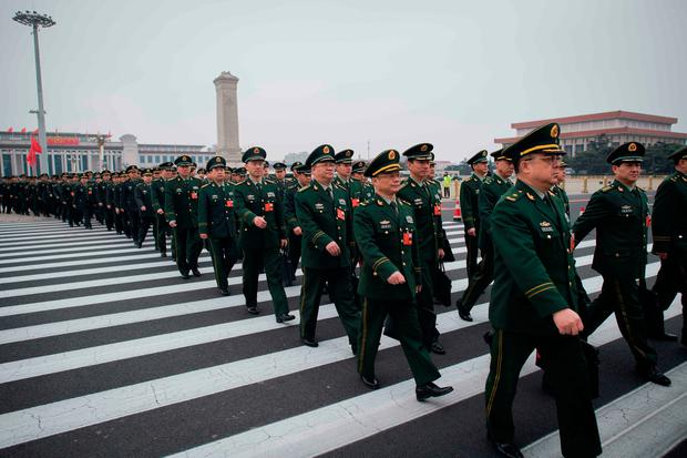 Military delegates arrive for the National People's Congress in Beijing yesterday. Photo: Nicolas Asfouri/Getty