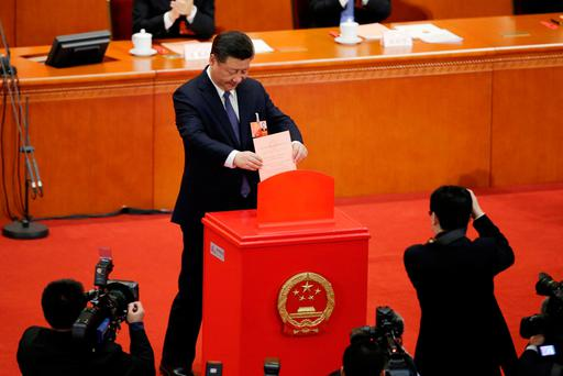 Chinese President Xi Jinping drops his ballot, during a vote on a constitutional amendment lifting presidential term limits, at the third plenary session of the National People's Congress (NPC) at the Great Hall of the People in Beijing, China. REUTERS/Jason Lee