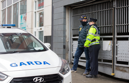 Gardaí on duty outside the apartments where arrests were made and firearms seized in Gardener Street in Dublin