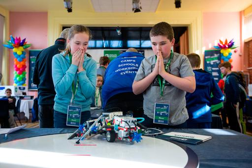 The pressure is intense as team mates Anna Gleeson and Noah Connell from Monaleen watch their robot do battle at the Analog Devices Primary School Robotics Championship. Picture: Sean Curtin