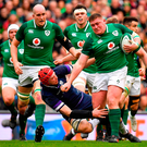 Ireland's Tadhg Furlong bursts through the tackle of Grant Gilchrist during Ireland's victory over Scotland. Photo: Sportsfile
