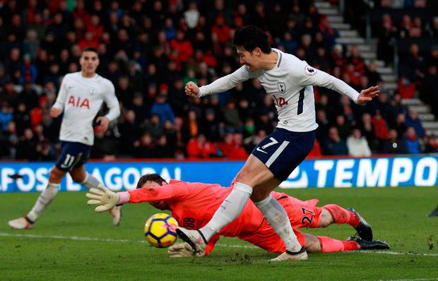 Tottenham's Son Heung-min rounds Bournemouth's Asmir Begovic to score their third goal. Photo: Reuters/Ian Walton