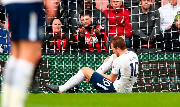 Tottenham Hotspur's Harry Kane holds his ankle after a challenge during the Premier League match. Photo credit: John Walton/PA Wire
